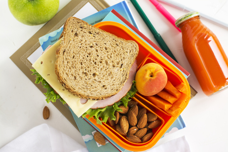 dinnertime: Kids lunch box with healthy meal. Back to school concept. Selective focus