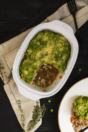 comfy: Comfy food - casserole with ground meat, vegetables, pea puree and parmesan. Top view. Selective focus
