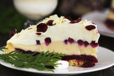 christmas cake with cranberry cheesecreme and white chocolate selective focus stock photo 60523873