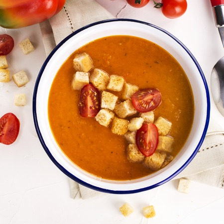 garnished: Tomato and carrot soup garnished with croutons