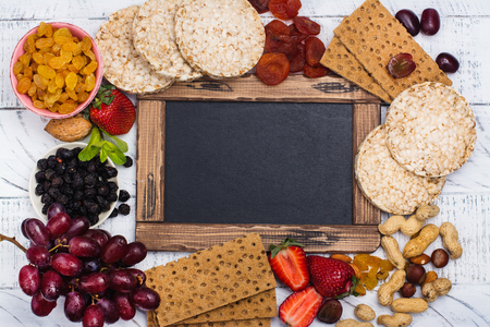 Assortment of healthy snacks. Kids school lunch or diet concept. Copy space Stock Photo
