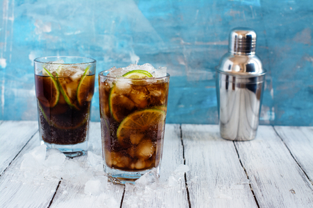 Summer cuba libre cocktail with lime and mint. Space for text Stock Photo