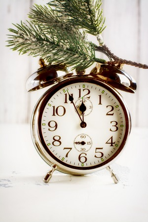 counting five: Retro alarm oclock showing five minutes to midnight. Xmas or new year concept. Selective focus. Space for text