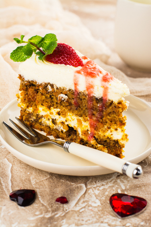 Carrot cake with strawberry sauce and mint. Selective focus