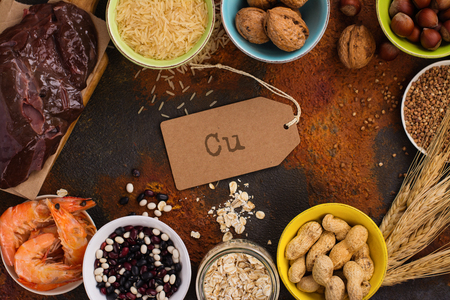 銅 (Cu) の食品の豊富な。下肢静脈瘤に対しての高いヘモグロビンの健康的な食事と貧血。トップ ビュー 写真素材