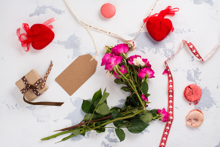 After party mess with flowers, gift box, cookies and decorative hearts. Top view. Space for text Stock Photo