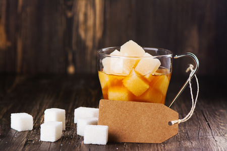 glycemic: Excessive portion of sugar in mug with tea. Health care or diabetes concept Stock Photo