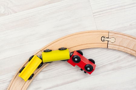 Colorful wooden toy train on laminated floor. Copy space Archivio Fotografico