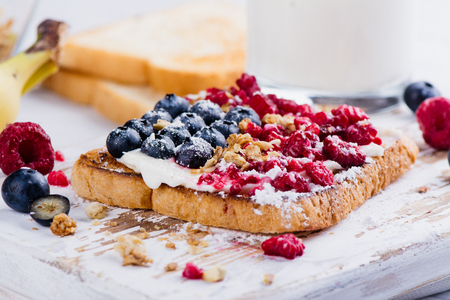Delicious breakfast 4th july theme toasts with cream cheese and berris. Independence day dessert Stock Photo