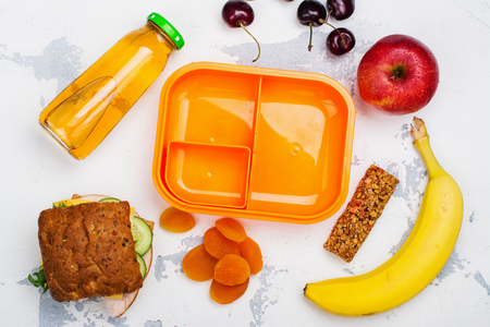 Lunch box, sandwich and fruits. Back to School concept. Flat lay style