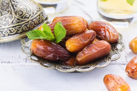 Dry dates and mint tea. Ramadan Kareem holiday concept Stock Photo