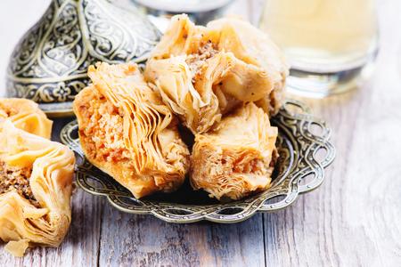 Traditional arabic sweet dessert Baklava on wooden table