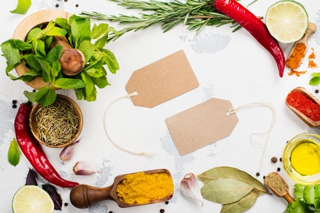 thyme: Selection of herbs and spices on white stone table. Copy space