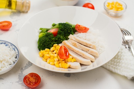 Balanced meal or diet concept. Chicken with rice and vegetables Stock Photo