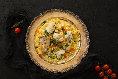 Couscous with fish and vegetables on stone table 版權商用圖片