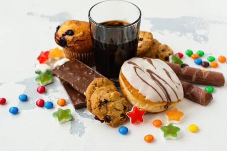 Assortment of products with high sugar level. Food thats bad for skin and teeth. Space for text Stock Photo