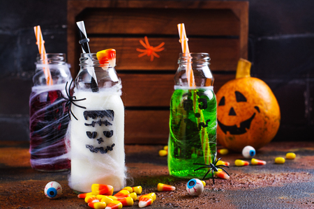 Assortment of Halloween drinks on grunge background. Copy space