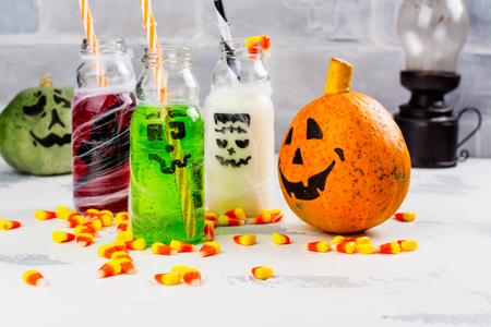 Assortment of Halloween drinks on white background. Copy space