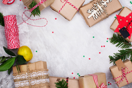 Many Christmas gifts on stone background. Winter holidays concept. Top view