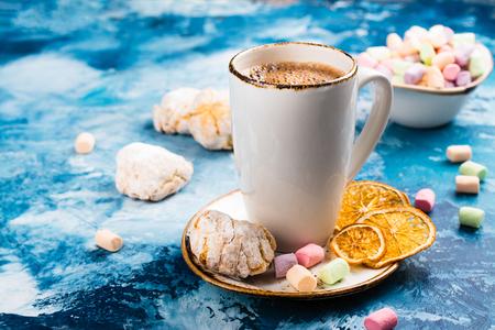 Hot chocolate with colorful marshmallows on festive Christmas background. Vintage style. Toned image Stock Photo
