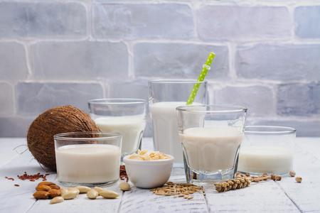 Assortment of non dairy vegan milk and ingredients Stock Photo - 92140951