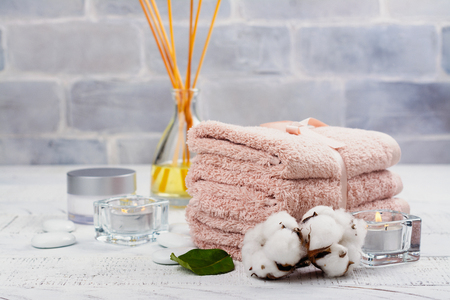 SPA or welness concept with cotton towels, soap and sea salt. Beauty or skin care concept. Copy space Stock Photo