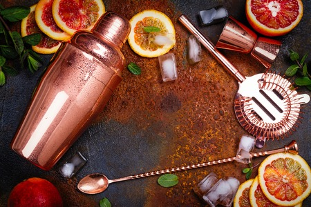 Bar accessories, drink tools and cocktail ingredients on rusty stone table. Flat lay style Stock Photo