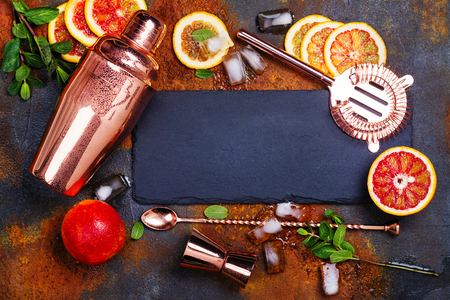 Bar accessories, drink tools and cocktail ingredients on rusty stone table. Flat lay style 版權商用圖片