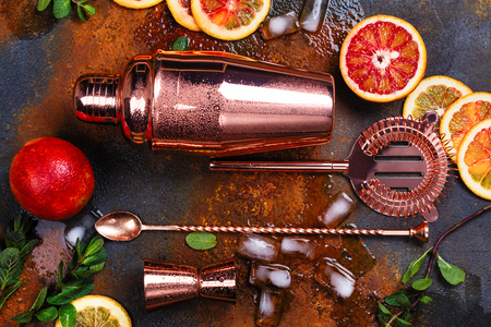 Bar accessories, drink tools and cocktail ingredients on rusty stone table. Flat lay style Stockfoto