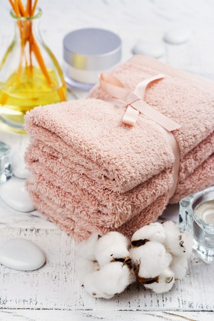 SPA or welness concept with cotton towels, soap and sea salt