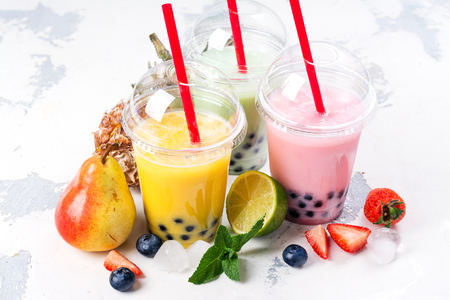 Refreshing homemade iced milky bubble tea with tapioca pearls