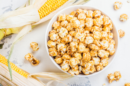 Caramel popcorn in a white bowl Stock Photo