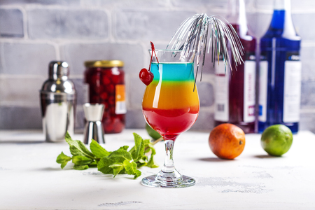 Summer rainbow layered cocktail