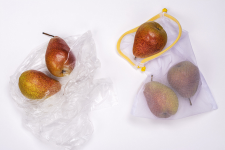 Fresh pears in eco and plastic bags Stok Fotoğraf