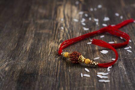 Indian rakhi bracelet on wooden background Stock Photo
