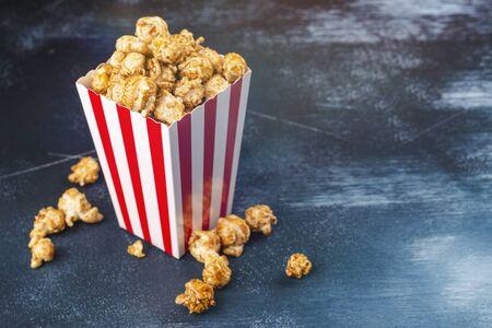 Caramel popcorn in a paper cup Stock fotó