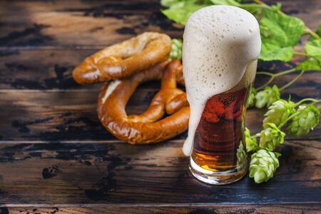 Golden beer and pretzels 写真素材