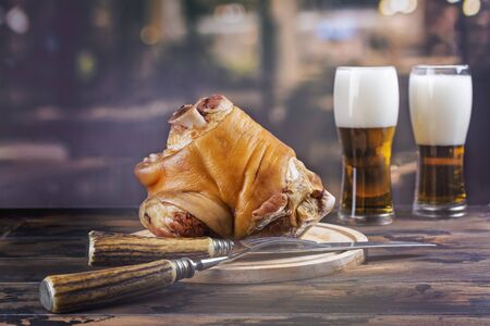Pork knuckle, beer and pretzels