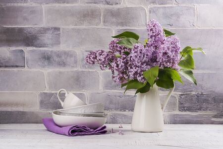 Bunch of lilac and crockery