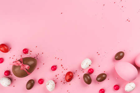 Easter chocolate eggs on pink