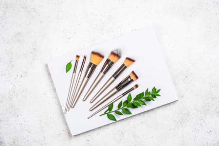 Makeup brushes on display stand