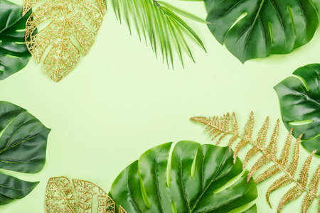 Golden painted tropical leaves