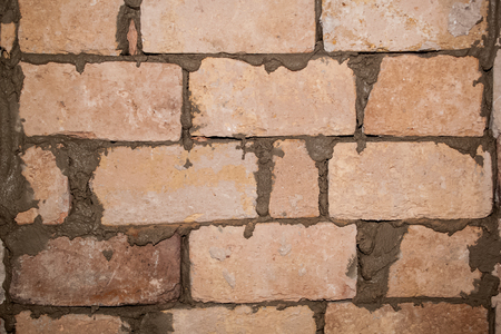 Flat renovation, the master made the wall and left to dry mortar, brick plant background, texture Stock Photo