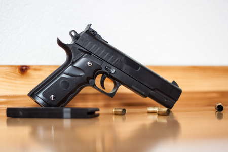 Gun on the floor, crime, the shell of the bullets next to the gun, robbery, murder, crime, mafia, crime scene