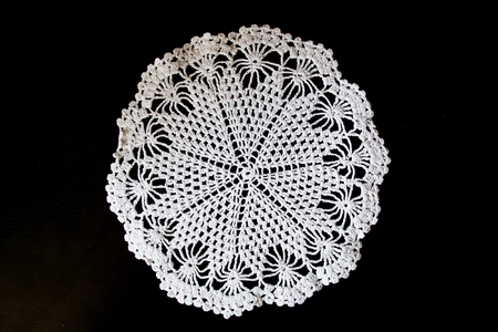 Handmade, white crochet, embroidery, on a black background, contrast