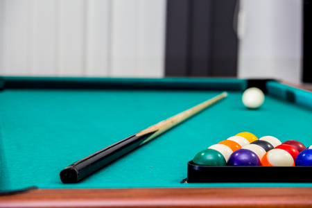Sports play, recreation, hobby, tactics, billiard table with triangle-shaped balls, white ball at the top of the table, billiards ply
