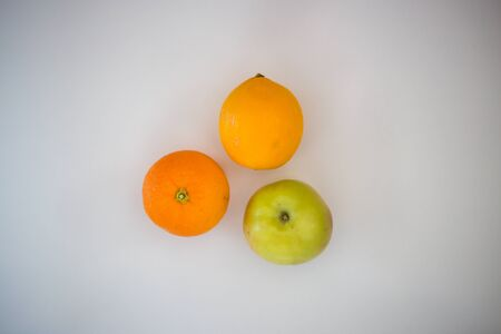 Apple, orange, lemon, on a white background, healthy life, vitamins, fruits Standard-Bild