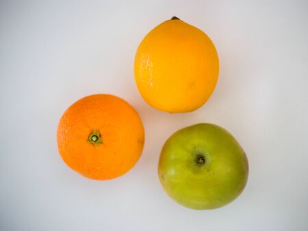 Apple, orange, lemon, on a white background, healthy life, vitamins, fruits Banque d'images
