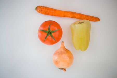 Tomato, pepper, onion, carrot on a white background, healthy life, vitamins, vegetables