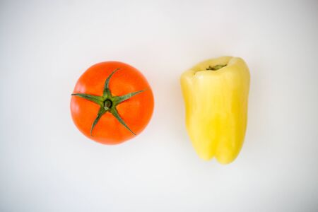 Tomato, pepper, on a white background, healthy life, vitamins, vegetables Banque d'images